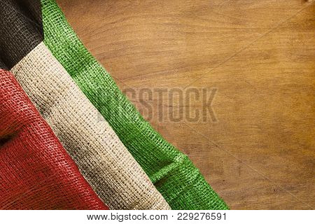 Flag Of Kuwait Made From Rough Fabric On A Wooden Background.