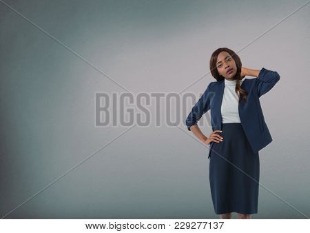 Digital composite of Businesswoman holding back of neck stressed and thinking