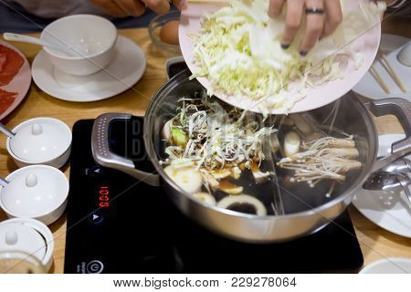 Vegetables Are Cooked In A Hot Pot Sukiyaki. (healthy Food)