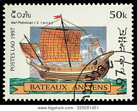 Moscow, Russia - March 03, 2018: A Stamp Printed In Laos Shows Ancient Phoenician Ship, Series