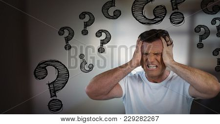 Digital composite of frustrated man with question marks