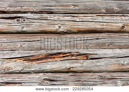 Wooden Logs Wall Of Old Rural House As Background Texture