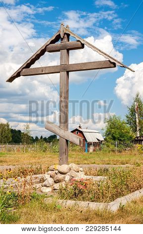 Wooden Orthodox Cross In Russian Village In Summer Sunny Day