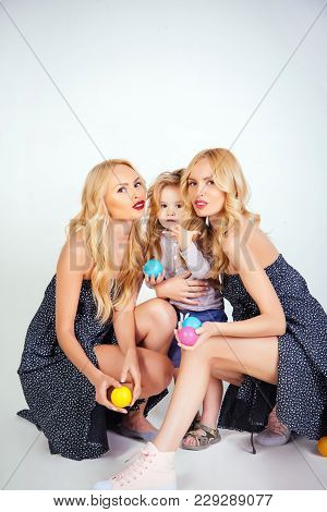 Happy Family Play With Toy Balls. Mothers Day, Family Values, Trust, Childhood. Love, Happiness, Par