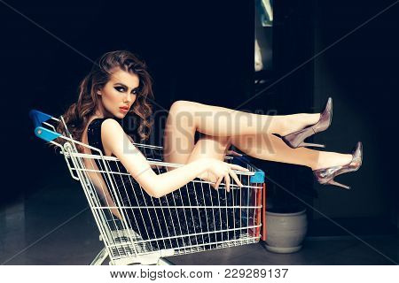 Shopper, Shopaholic, Shopping, Shop. Sensual Woman Sit In Shopping Cart. Girl In Fashionable Dress,