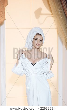 Girl With Towel On Head With Nude Chest Dressing After Shower. Sexy Lady With Calm Face Takes Off He