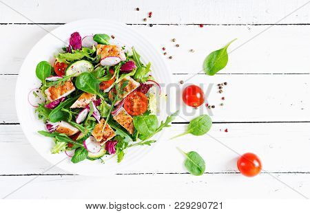Fresh Vegetable Salad With Grilled Chicken Breast   - Tomatoes, Cucumbers, Radish And Mix Lettuce Le
