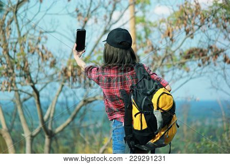 Asia ,young Woman Backpacker And Selfie Pictures With Backpack Traveling Alone Forest, Relax Time On