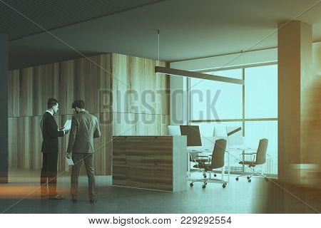 Wooden Office Cubicles In A Room With Gray Walls, A Concrete Floor And Large Windows. A Side View. B