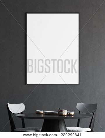 Minimalistic Gray Dining Room Interior With A Round Wooden And Black Table And Chairs. A Framed Vert