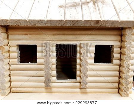 Wooden Homes Hand-rolled On The Shelves Of The Store Are Sold