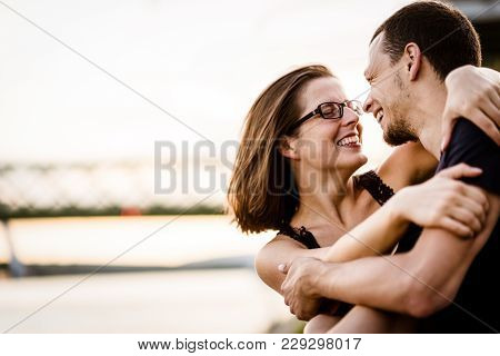 Happy Young Couple Embracing Each Other With Love