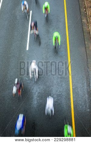 Cycling Riders Road Race Speed Blur Motion Of Peleton Cyclists And Individual Unidentified Overhead