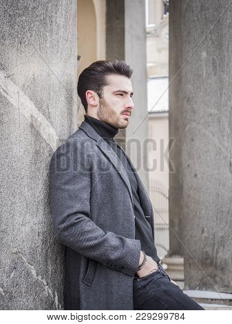 Handsome Bearded Young Man Outdoor In Winter Fashion, Wearing Black Turtleneck Sweater And Woolen Bl