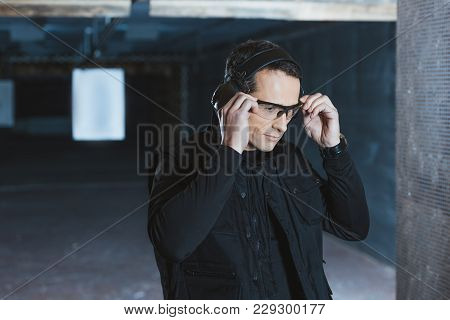 Handsome Man Wearing Safety Glasses In Shooting Range