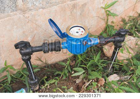 Water Meter Blue With Black Water Pipe. Sanitary Equipment.