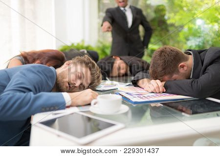 In Selective Focus Of Business People Sleeping In The Conference Room During A Meeting.