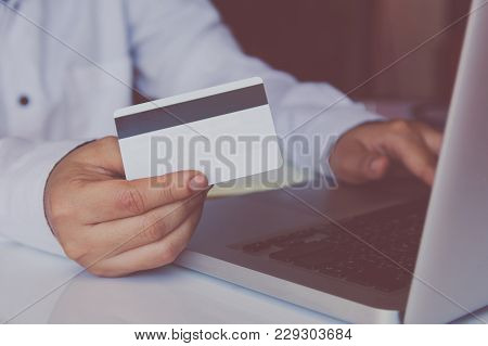 Man Hand Holding Credit Card And Using Laptop Making Online Payment Online, Online Shopping