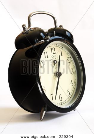 black retro-styled alarm clock - close up on white background. poster