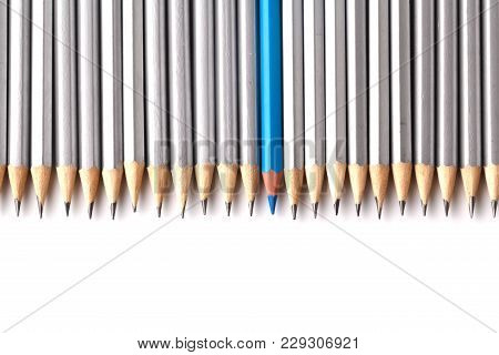 Bright Pencil Standing Out From Crowd Of Plenty Identical Black Fellows On White Table. Leadership,