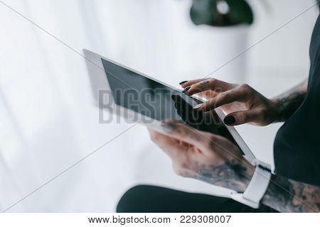 Partial View Of Businesswoman Using Digital Tablet With Black Screen