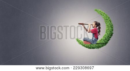Cute Kid Girl Sitting On Green Moon And Looking In Spyglass