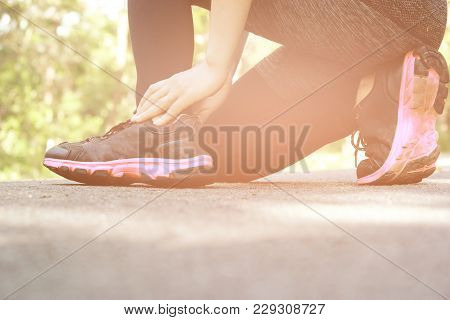 Young Woman Injuries  While Exercising And Running. Sport Exercise Injuries Concept.