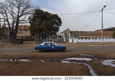 Bissau, Republic Of Guinea-bissau - January 28, 2018: A Taxi In The Amilcar Cabral Avenue (avenida A