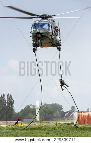 Beauvechain, Belgium - May 20, 2015: Soldiers Fast-roping From An Army Nh90 Helicopter.
