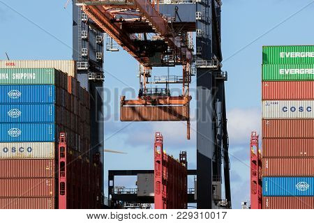 Rotterdam, The Netherlands - Sep 2, 2017: Container Ship Being Loaded By Gantry Cranes In The Maasvl