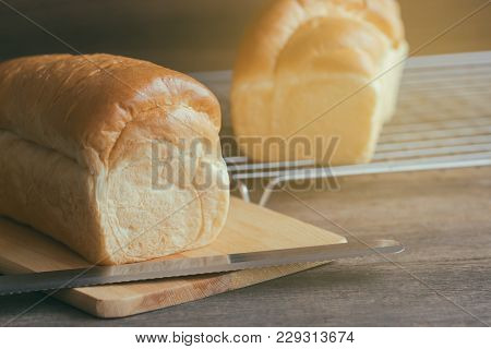 Soft And Sticky Delicious White Bread On Wood Cutting Board And On Cooling Rack. Prepare Bread For B