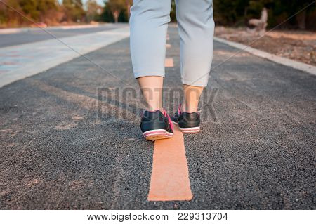 Walking On Yellow Street Lines. Asphalt Surface On The Road Texture,