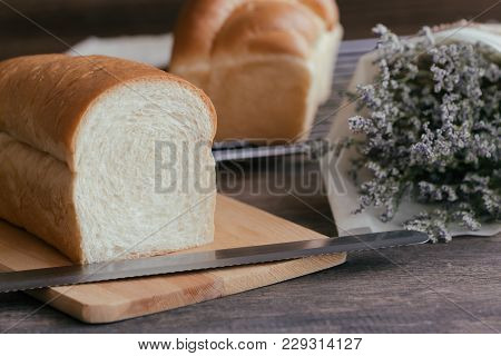 Soft And Sticky Delicious White Bread On Wood Cutting Board And Cooling Rack. Prepare Bread For Brea