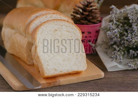 Sliced Soft And Sticky Delicious White Bread On Wood Cutting Board. Prepare Bread For Breakfast On W