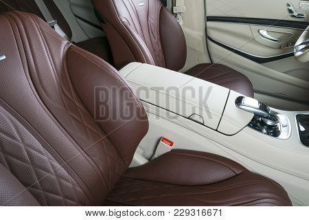 Modern Luxury Car Inside. Interior Of Prestige Modern Car. Comfortable Leather Seats. Red Perforated