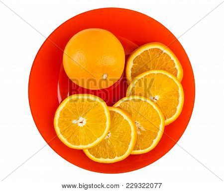 Whole Orange And Slices Of Orange In Red Plate Isolated On White Background. Top View