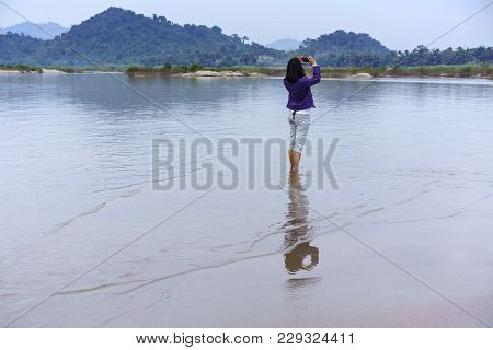 Asian Female Tourist Using Mobile Phone Taking Beautiful Picture Of Nong Khai Grand Canyon Or Phan K