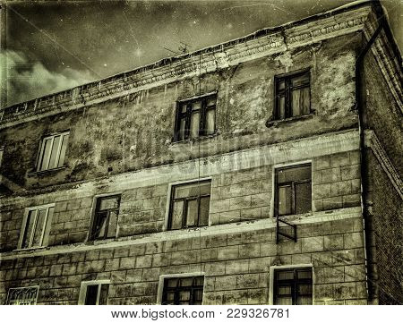 Very Old Apartment Building. Old Architeture. Old Town. Vintage Photo. Stylization. Green Grunge