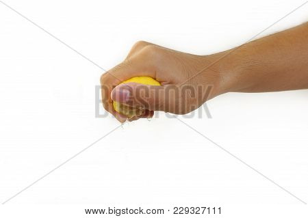 Male Hand Squeezing Lemon On White Background