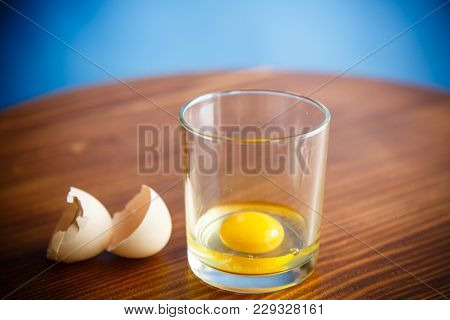 Raw Egg In A Glass Beaker With Shell