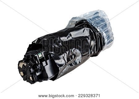 Unpacked Cartridge, In A Black Bag Isolated On White Background.