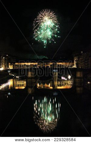 Florence, Italy - June 24 2013: Fireworks By The Historic Ponte Vecchio Bridge In Florence, For The