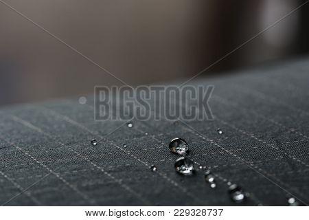 Rain Water Droplets On  Black Waterproof Fabric