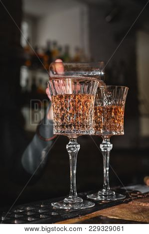 Barman Filling Up Glasses With Wine; Waiter Pouring Wineglasses With Champagne Or Martini;