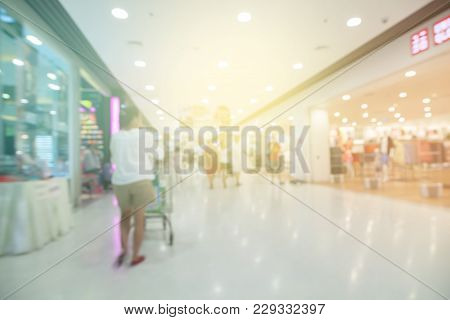 Blurred Defocused Background Of Generic Supermarket People Walking Shopping