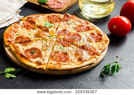 Pepperoni Pizza - Fresh Homemade Pizza With Pepperoni, Cheese And Tomato Sauce On Rustic Black Stone