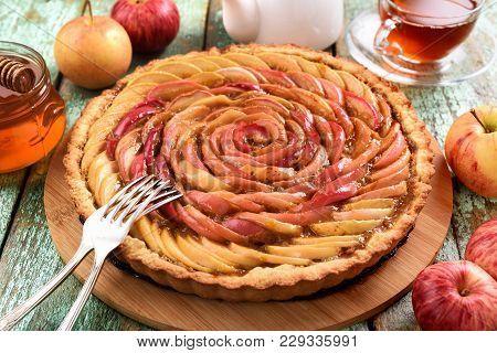Homemade Apple Rose Cake. Healthy Delicious Cake With Tea, Honey And Fresh Apples And Silverware On