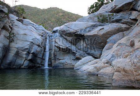 Waterfall And Natural Swimming Pool At Cascada Sol Del Mayo On The Baja California Peninsula In Mexi