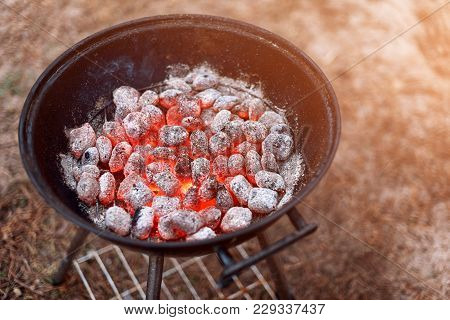 Bbq Grill With Glowing And Flaming Hot Charcoal Briquettes, Closeup, Top View