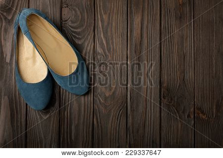 Blue Women's Shoes (ballerinas) On Wooden Background.